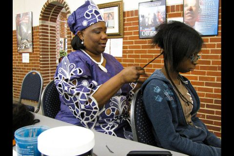 LaVonda Harris Price, master artist, demonstrating hair weaving. (Calvin Sneed)