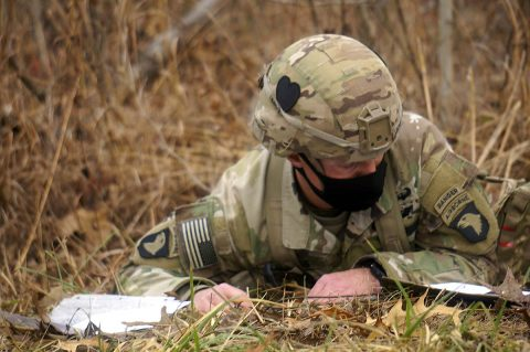 Expert Soldier Badge candidate Maj. James Lucas plots navigation points on his map during ESB land navigation testing at Fort Campbell, Kentucky. (Capt. Steven Guevara, 2nd Brigade Combat Team, 101st Airborne Division (Air Assault))
