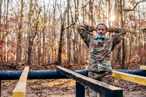 """Austin Peay State University junior cadet Devin Antoine negotiates the """"leg over"""" at the Air Assault School obstacle course. (APSU)"""