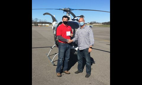 Austin Peay State University aviation student Samuel Nicholas, left, after earning his private pilot certificate. (APSU)