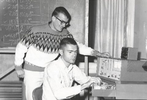 Harold Dewein and Ronald Miller test air samplings. (The All State)