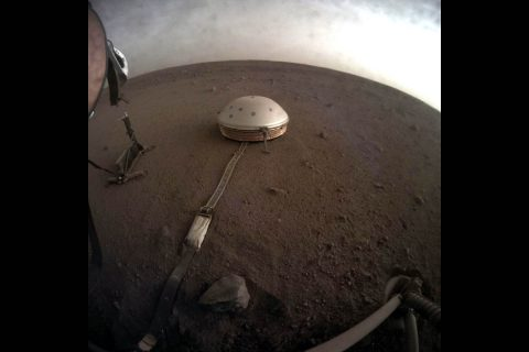Clouds drift over the dome-covered seismometer, known as SEIS, belonging to NASA's InSight lander, on Mars. (NASA/JPL-Caltech)