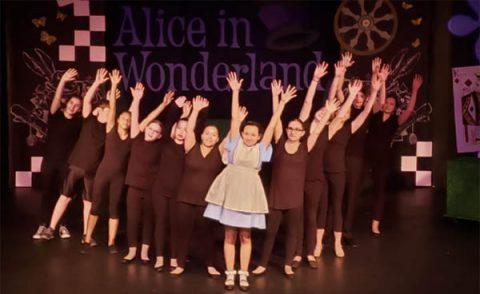 Roxy Regional Theatre School of the Arts students performing in 2019's production of Disney's Alice in Wonderland, Jr.