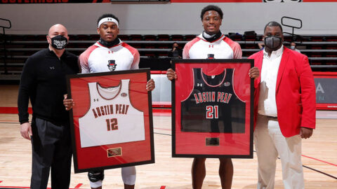 Austin Peay State University Men's Basketball seniors (L to R) Reginald Gee and Terry Taylor were honored before the game on Senior Night at the Dunn Center. (Robert Smith, APSU Sports Information)