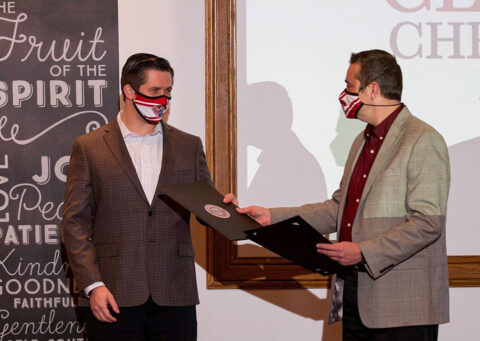 Receiving Award From Dr. Brad Moser, Mr. Wes Golden. (Gary Stonesifer)