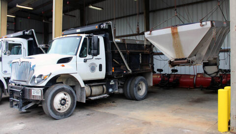 A Clarksville Street Department truck, fitted with a salt box, is ready to roll if ice begins to hit area roads. A salt box ready to be placed on another truck hangs in the next bay at the Street Department equipment garage.