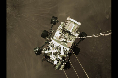 This high-resolution still image is part of a video taken by several cameras as NASA's Perseverance rover touched down on Mars on Feb. 18, 2021. A camera aboard the descent stage captured this shot. A key objective for Perseverance's mission on Mars is astrobiology, including the search for signs of ancient microbial life. (NASA/JPL-Caltech)