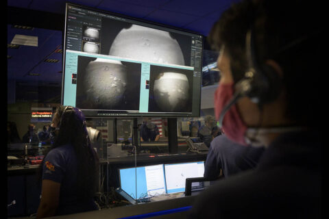 Members of NASA's Perseverance Mars rover team watch in mission control as the first images arrive moments after the spacecraft successfully touched down on Mars, Thursday, Feb. 18th, 2021, at NASA's Jet Propulsion Laboratory in Pasadena, California. (NASA/Bill Ingalls)