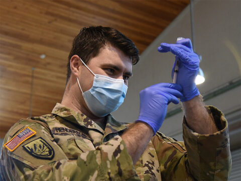 Sgt. Dillon Henderson with Smyrna's 208th Medical Company prepares to administer the Moderna vaccine at Smyrna's Volunteer Training Site on January 28th. (Sgt. 1st Class Edgar Castro)