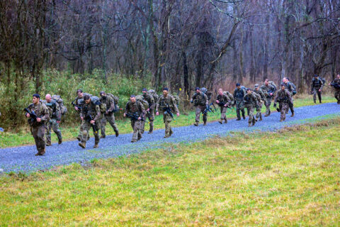 """Squad Leaders from 1st Battalion, 506th Infantry Regiment """"Red Currahee"""", 1st Brigade Combat Team """"Bastogne"""", 101st Airborne Division (Air Assault), conduct a culminating foot march during Toccoa Tough II, a leadership professional development course March 8-12, on post. (Sgt. Lynnwood Thomas)"""