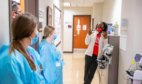Nursing students listen to instruction after a simulation. (APSU)