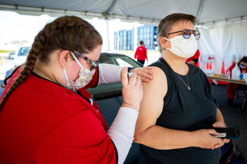 Austin Peay State University nursing student Dominique Brockman gives the vaccine to her mother, Dr. Beatrix Brockman. (APSU)