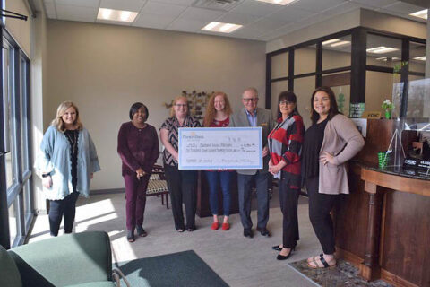 Customs House Museum recieves check at Planters Bank's Hilldale Branch.