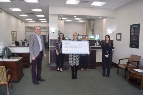 Gateway Chamber Orchestra receives check at Planters Bank's Sango Branch.
