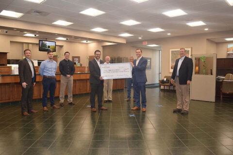 Kiwanis Club of Clarksville receives check at Planters Bank 's Commerce Branch.