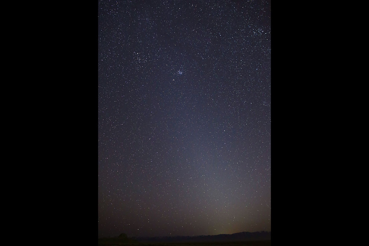 This photo shows the zodiacal light as it appeared on March 1st, 2021, in Skull Valley, Utah. The Pleiades star cluster is visible near the top of the light column. Mars is just below that. (NASA/JPL-Caltech)