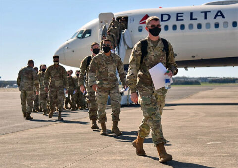 More than 100 Soldiers from the 252nd Military Police Company arrive in Smyrna on March 26, following an 11-month deployment in support of Operation Enduring Freedom. (Staff Sgt. Tim Cordeiro)