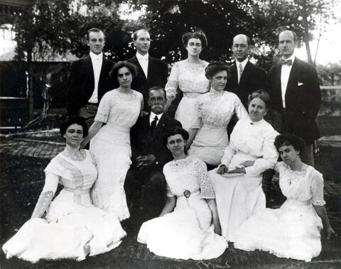 The Bringhurst Family: Lulu (seated far left), her parents Billie and Sallie, and 9 siblings