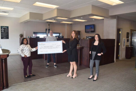 The Roxy Regional Theatre receives check at Planters Bank's Rossview Branch.