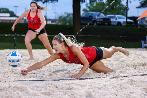 Austin Peay State University Beach Volleyball's Jenna Panning dives for the ball againsts UT Martin. Panning and Brooke Moore picked up the matching point securing victory for the Govs. (Eric Elliot, APSU Sports Information)