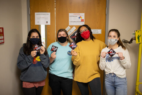 "One of the Austin Peay State University students show off their ""I Escaped Quant"" stickers. (APSU)"