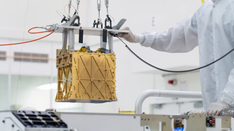 Technicians at NASA's Jet Propulsion Laboratory lower the Mars Oxygen In-Situ Resource Utilization Experiment (MOXIE) instrument into the belly of the Perseverance rover. (NASA/JPL-Caltech)