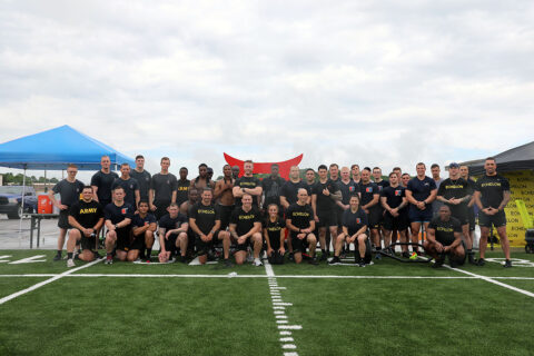 Soldiers with the 101st Airborne Division (Air Assault) and members of the fitness community pose for a group picture as part of a 5 on 5 fitness challenge on Fort Campbell, KY, May 28th, 2021. (Staff Sgt. Michael Eaddy)