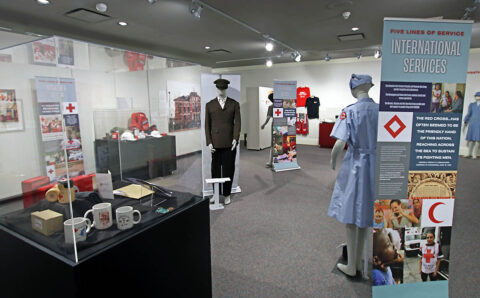 "Customs House Museum and Cultural Center's Red Cross exhibit ""Helping Americans Help Themselves: 140 Years of the Red Cross""."