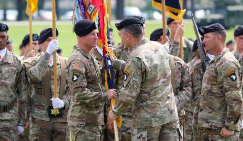 Maj. Gen. J.P. McGee, commander of the 101st Airborne Division (Air Assault), passes the brigade colours to Col. Mark Federovich, the incoming commander of the 3rd Brigade Combat Team, 101st Airborne Division (Air Assault), during a change of command ceremony on Fort Campbell, KY June 18th, 2021. (Staff Sgt. Michael Eaddy)