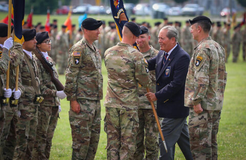Col. Mark Federovich, incoming commander of the 3rd Brigade Combat Team, 101st Airborne Division (Air Assault), receives the regimental colours from Command Sgt. Maj. (Retired) Gerald Counts, the Honorary Colonel of the 187th Infantry Regiment, during a change of command ceremony on Fort Campbell, KY June 18, 2021. (Staff Sgt. Michael Eaddy)