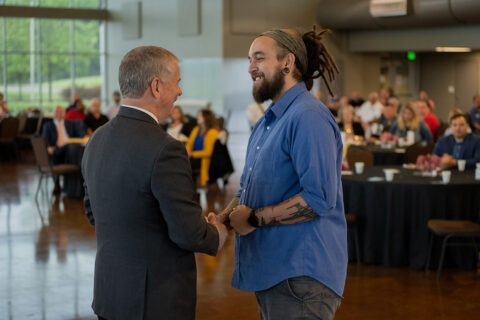 Ryan Milton, right, an Applications Specialist in the Clarksville Information Technology Department, gets a handshake from Clarksville Mayor Joe Pitts at the Cause for Applause event. Milton was chosen as one of the City's Rising Stars and honored during the annual appreciation breakfast on Wednesday.