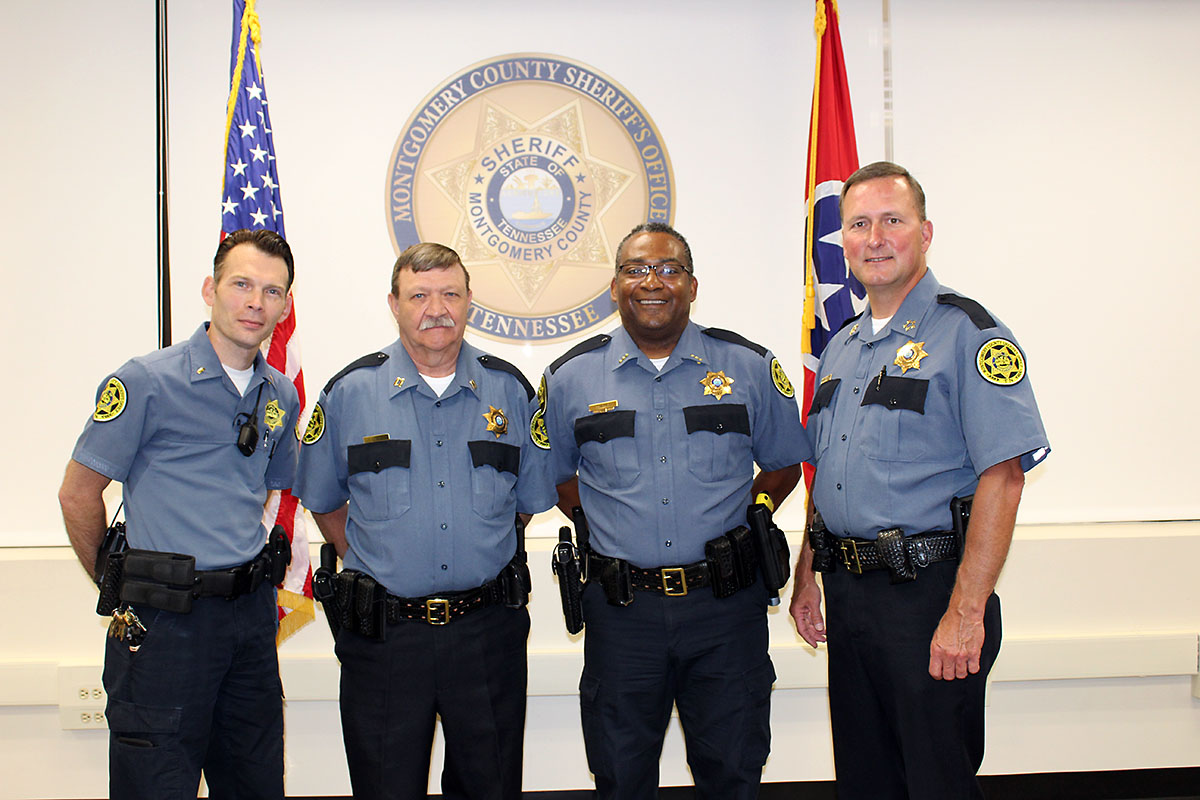 (L to R) Joseph Welch, Harold Stilts, and Joe Thomas are congradulated by Montgomery County Sheriff John Fuson on their promotions.