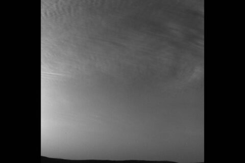 NASA's Curiosity rover captured this drifting clouds image on May 7th, 2019, the 2,400th Martian day, or sol, of the mission. Curiosity used its black-and-white Navigation Cameras to take the photo. (NASA/JPL-Caltech)