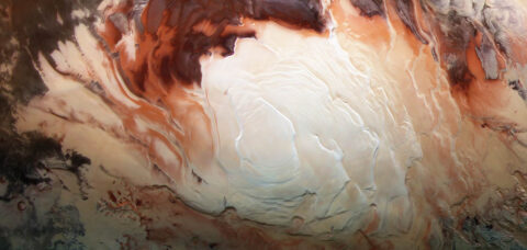 The bright white region of this image shows the icy cap that covers Mars' south pole, composed of frozen water and frozen carbon dioxide. ESA's Mars Express imaged this area of Mars on Dec. 17, 2012, in infrared, green and blue light, using its High Resolution Stereo Camera. (ESA/DLR/FU Berlin/Bill Dunford)