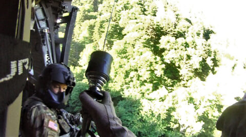 Sgt. Tim Allen begins hoist operations and lowers Sgt. 1st Class Tracy Banta, a Critical Care Flight Paramedic, to a bear attack victim in the Great Smoky Mountain National Park Area, June 18th. (Tennessee National Guard)