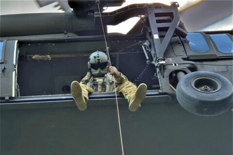 Sgt. Tim Allen lowers Sgt. 1st Class Tracy Banta, a Critical Care Flight Paramedic, to a bear attack victim in the Great Smoky Mountain National Park Area, June 18th. (Tennessee National Guard)