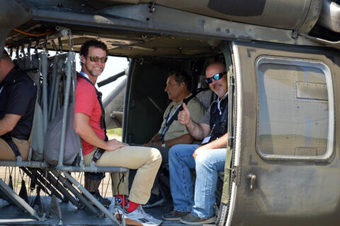 Monte Cooper, Senior Vice President of the Electric Division at Jackson Energy Authority, left, Harlin Trefz, Owner of Trefz Design International, center,)and Scott Jones, a Quality Manager at LyondellBasell Industries, right, pose for a picture aboard a Tennessee Army National Guard UH-60 Blackhawk assigned to the 1/230th Assault Helicopter Battalion in Jackson. (Sgt. Finis L. Dailey, III)