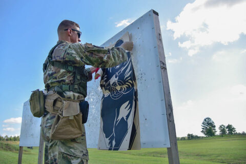 A member of the Tennessee National Guard takes down a target at a rifle range, June 27th, during the TAG Match, at Tullahoma's Volunteer Training Site. The TAG Match is an annual marksmanship competition and training event that is hosted by the Tennessee Combat Marksmanship Program. (Sgt. 1st Class Timothy Cordeiro)