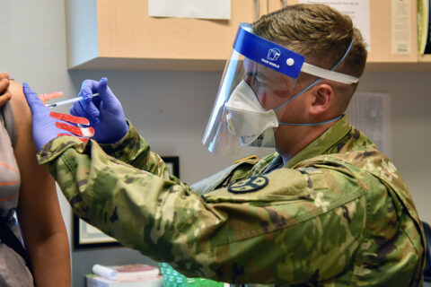 Spc. Anthony Spencer with the Tennessee National Guard gives a vaccination to a patient at the Trousdale County Health Department on June 9th. (Lt. Col. Darrin Haas, Tennessee National Guard)