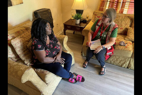 Mary Wallace speaks with Red Cross Disaster Program Manager Abigail Okui following her Home Fire Campaign smoke detector installment. Six people escaped a home fire at Wallace's home in 2019 after a Home Fire Campaign visit from volunteers.