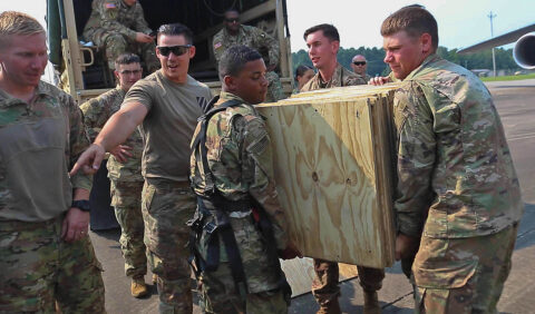 Soldiers from Bravo Company, 326th Engineer Battalion, 1st Brigade Combat Team, 101st Airborne Division (Air Assault), load equipment on a C5 as part of cold load operations during an Emergency Deployment Readiness Exercise July 22, 2021, at Fort Campbell, KY. Soldiers and Airmen worked together to load the C-5 with wooden boxes used to simulate cargo, a dozer used for route clearance, and a Buffalo Mine-Protected Clearance Vehicle. (Spc. Jacob Wachob, 40th Public Affairs Detachment)