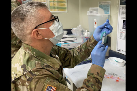 U.S. Army Pharmacist Maj. Mark Olson draws a dose of COVID-19 vaccine for use in Blanchfield Army Community Hospital's COVID-19 vaccination clinic earlier this year. The hospital operates the vaccination site on Fort Campbell, Kentucky, which was recognized June 28th for its high vaccination rate among active-duty service members in the Department of Defense. (U.S. Army photo by Maria Yager)