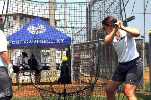 Captain Alexandrea Rashenskas, 759th Military Police Battalion, Fort Carson, Colo., takes practice swings off the tee July 23 at Fort Campbell. Tryouts started July 22 and will continue through Aug. 2 when coaching staff makes the final cut. (Sirena Clark, Fort Campbell Public Affairs Office)