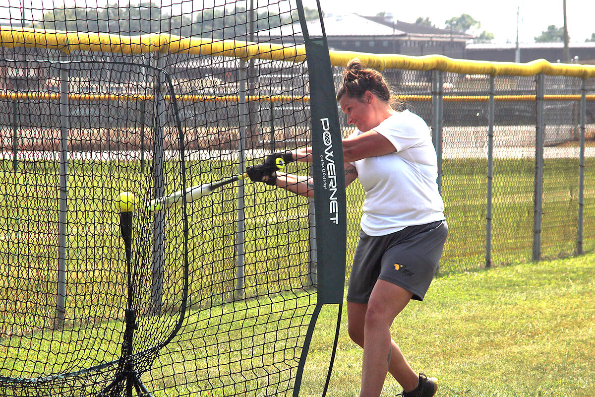 Staff Sergeant Kathryn Pena, 1st Brigade Combat Team, 101st Airborne Division (Air Assault), takes practice swings off the tee July 23 at Fort Campbell. Tryouts started July 22 and will continue through Aug. 2 when coaching staff makes the final cut. (Sirena Clark, Fort Campbell Public Affairs Office)
