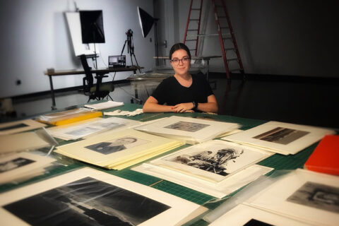 Katie Boyer with some of the photos she's working with this summer. (APSU)