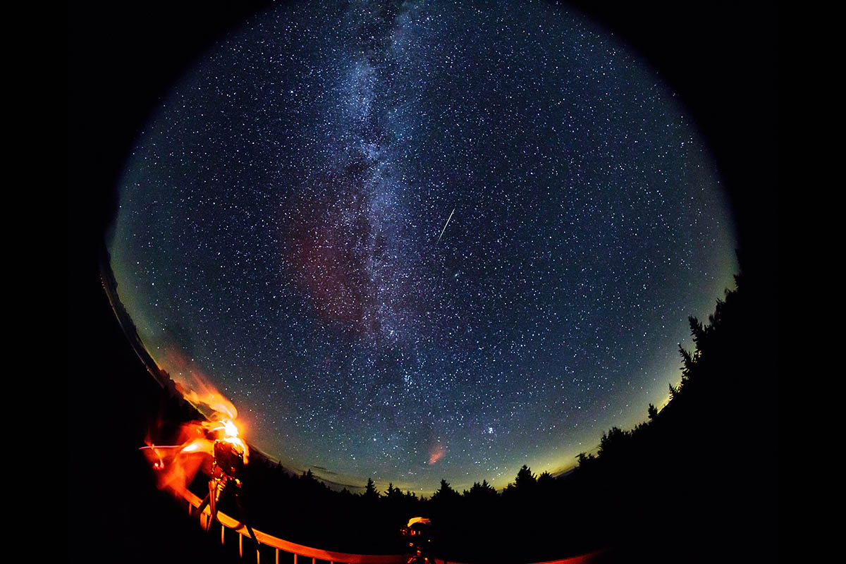 In this 30 second exposure taken with a circular fish-eye lens, a meteor streaks across the sky during the annual Perseid meteor shower on Friday, August 12th, 2016 in Spruce Knob, West Virginia. (NASA, Bill Ingalls)