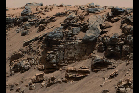 This evenly layered rock photographed by the Mast Camera (Mastcam) on NASA's Curiosity Mars Rover shows a pattern typical of a lake-floor sedimentary deposit not far from where flowing water entered a lake. (NASA/JPL-Caltech/MSSS)