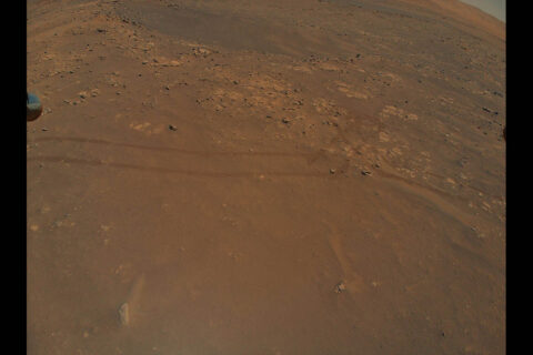 NASA's Ingenuity Mars Helicopter captured this image of tracks made by the Perseverance rover during its ninth flight, on July 5. A portion of the helicopter's landing gear can be seen at top left. (NASA/JPL-Caltech)