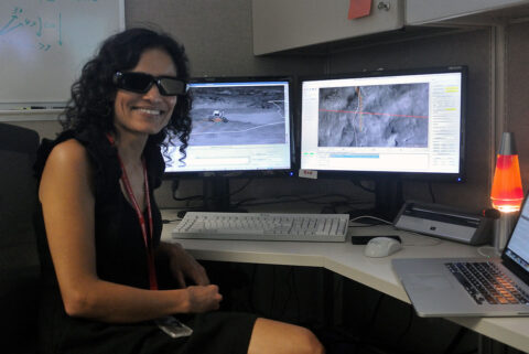 Vandi Verma, an engineer who now works with NASA's Perseverance Mars rover, is seen here working as a driver for the Curiosity rover. The special 3D glasses she's wearing are still used by rover drivers to easily detect changes in terrain that the rover may need to avoid. (NASA/JPL-Caltech)