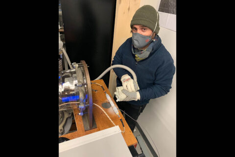 Isaac Smith of Toronto's York University bundled up while working in a lab, freezing smectite clays with liquid nitrogen to test how they respond to radar signals. The results have challenged the hypothesis that subsurface lakes can be found at Mars' south pole. (York University/Craig Rezza)